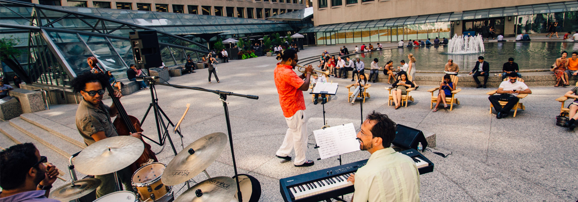 Musicians play outdoors at Commerce Court
